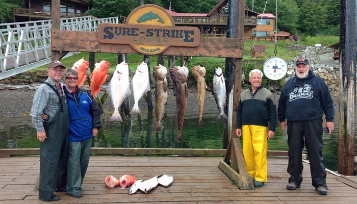 the inkeepers posing next to caught fish.